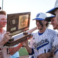 Bluestem Lion Seniors gather around the State Championship trophy. The Bluestem Lions defeated the Ellis Railroaders 8 to 5 in the KSHSAA Class 2-1A State Baseball Championship game at Great Bend Sports Complex in Great Bend, Kansas on May 26, 2017. (Photo: Joey Bahr, www.joeybahr.com)