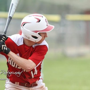 Hoisington Cardinal #14 Alex Schremmer waits for a pitch to arrive in the bottom of the first inning. The Pratt Greenbacks defeated the Hoisington Cardinals 12 to 0 at Bicentennial Park in Hoisington, Kansas on May 9, 2017. (Photo: Joey Bahr, www.joeybahr.com)