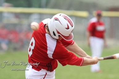 Hoisington Cardinal #8 Hunter Hanzlick fouls off a pitch in the bottom of the first inning. The Pratt Greenbacks defeated the Hoisington Cardinals 12 to 0 at Bicentennial Park in Hoisington, Kansas on May 9, 2017. (Photo: Joey Bahr, www.joeybahr.com)