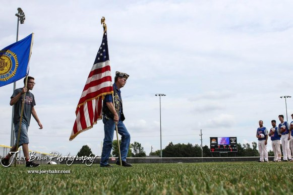 Members of the American Legion Post 180 Honor Guard take the colors onto the field prior to the start of the AAA Zone Tournament. The McPherson American Legion Post 24 AAA Seniors defeated the Hutchinson American Legion Post 68 AAA Colts 6 to 4 to advance to the AAA Zone 8 Championship at the Great Bend Sports Complex in Great Bend, Kansas on July 15, 2017. (Photo: Joey Bahr, www.joeybahr.com)