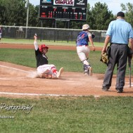 Great Bend Chief Jared Maneth (#7) slides into home to score a run in the bottom of the third inning. The Great Bend American Legion Post 180 AAA Chiefs defeated the McPherson American Legion Post 24 AAA Seniors 9 to 8 to win the AAA Zone 8 Championship at the Great Bend Sports Complex in Great Bend, Kansas on July 15, 2017. (Photo: Joey Bahr, www.joeybahr.com)