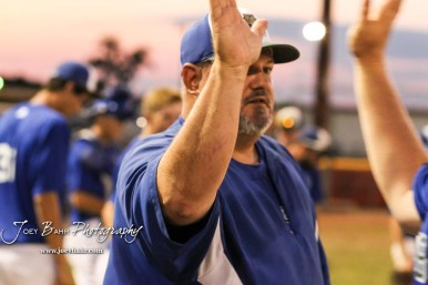 Great Bend Batcat Head Coach Roger Ward high fives a player at the conclusion of the game. The Great Bend Batcats won the second game of the series with the Liberal Bee Jays 8 to 3 at Al Burns Memorial Field in Great Bend, Kansas on July 8, 2017. (Photo: Joey Bahr, www.joeybahr.com)