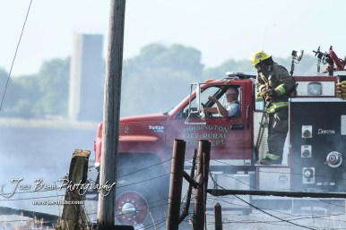 Mike Riese with the Hoisington Fire Department points out a hotspot to a fellow firefighter. Members of the Olmitz, Hoisington, and Galatia Fire Departments respond to a controlled burn that got out of control two miles north of the junction of Kansas Highway 4 and US Highway 281 near Hoisington, Kansas on July 1, 2017. (Photo: Joey Bahr, www.joeybahr.com)