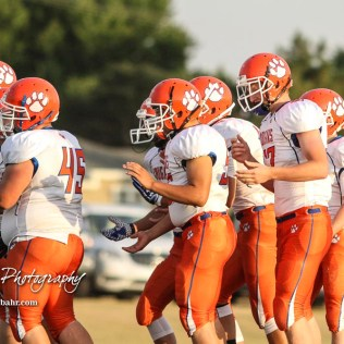 The Otis-Bison Cougars break their huddle and head to the line of scrimmage in the first quarter. The Central Plains Oilers defeated the Otis-Bison Cougars by a score of 36 to 12 at Central Plains High School in Claflin, Kansas on September 15, 2017. (Photo: Joey Bahr, www.joeybahr.com)