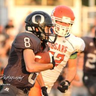 Central Plains Oiler #8 Anthony Oberle rushes with the ball as Otis-Bison Cougar #52 Luke Higgason tries to close in in the first quarter. The Central Plains Oilers defeated the Otis-Bison Cougars by a score of 36 to 12 at Central Plains High School in Claflin, Kansas on September 15, 2017. (Photo: Joey Bahr, www.joeybahr.com)