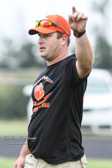 Otis-Bison Cougar Head Coach Travis Starr addresses his players during warmups prior to the start of the game. The Otis-Bison Cougars defeated the St. John Tigers by a score of 58 to 0 at St. John High School in St. John, Kansas on September 1, 2017. (Photo: Joey Bahr, www.joeybahr.com)