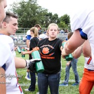 Jenna Hlavaty hands out water bottles to players before the start of the game. The Otis-Bison Cougars defeated the St. John Tigers by a score of 58 to 0 at St. John High School in St. John, Kansas on September 1, 2017. (Photo: Joey Bahr, www.joeybahr.com)