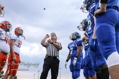 Captains from both team track the coin as it is tossed into the sky. The Otis-Bison Cougars defeated the St. John Tigers by a score of 58 to 0 at St. John High School in St. John, Kansas on September 1, 2017. (Photo: Joey Bahr, www.joeybahr.com)