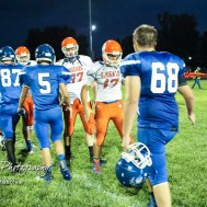 Members of the Otis-Bison Cougars and St. John Tigers shake hands following the game. The Otis-Bison Cougars defeated the St. John Tigers by a score of 58 to 0 at St. John High School in St. John, Kansas on September 1, 2017. (Photo: Joey Bahr, www.joeybahr.com)