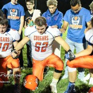 Otis-Bison Cougars #20 Bevan Gradig, #52 Luke Higgason, and #87 Maitland Wiltse hold hands during a post-game prayer. The Otis-Bison Cougars defeated the St. John Tigers by a score of 58 to 0 at St. John High School in St. John, Kansas on September 1, 2017. (Photo: Joey Bahr, www.joeybahr.com)
