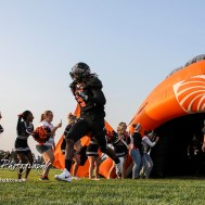 Larned Indian Damontay Phillips (#3) runs out to lead his team onto the field prior to the start of the game. The Larned Indians defeated the Smoky Valley Vikings by a score of 28 to 14 at Earl Roberts Stadium in Larned, Kansas on September 8, 2017. (Photo: Joey Bahr, www.joeybahr.com)