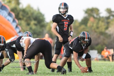 Larned Indian Carson Smith (#5) looks over the Smoky Valley Viking defense in the first quarter. The Larned Indians defeated the Smoky Valley Vikings by a score of 28 to 14 at Earl Roberts Stadium in Larned, Kansas on September 8, 2017. (Photo: Joey Bahr, www.joeybahr.com)