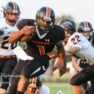 Larned Indian Anthony Mcconnell (#1) slips past the tackle of Smoky Valley Viking Carson Windholz (#22) in the first quarter. The Larned Indians defeated the Smoky Valley Vikings by a score of 28 to 14 at Earl Roberts Stadium in Larned, Kansas on September 8, 2017. (Photo: Joey Bahr, www.joeybahr.com)