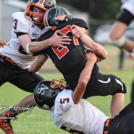 Smoky Valley Vikings Jacob Adams (#83) and Kyle Anderson (#5) team up to stop Larned Indian Mason Burris (#27) in the second quarter. The Larned Indians defeated the Smoky Valley Vikings by a score of 28 to 14 at Earl Roberts Stadium in Larned, Kansas on September 8, 2017. (Photo: Joey Bahr, www.joeybahr.com)