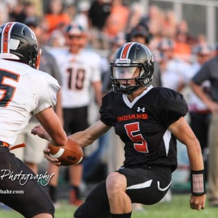 Larned Indian Carson Smith (#5) looks to juke away from Smoky Valley Viking Kyle Anderson (#5) in the second quarter. The Larned Indians defeated the Smoky Valley Vikings by a score of 28 to 14 at Earl Roberts Stadium in Larned, Kansas on September 8, 2017. (Photo: Joey Bahr, www.joeybahr.com)