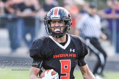 Larned Indian Mason Perez (#9) celebrates receiving a touchdown scoring pass in the second quarter. The Larned Indians defeated the Smoky Valley Vikings by a score of 28 to 14 at Earl Roberts Stadium in Larned, Kansas on September 8, 2017. (Photo: Joey Bahr, www.joeybahr.com)