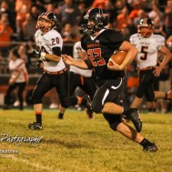 Larned Indian Wes Davis (#23) rushes with the ball in the third quarter. The Larned Indians defeated the Smoky Valley Vikings by a score of 28 to 14 at Earl Roberts Stadium in Larned, Kansas on September 8, 2017. (Photo: Joey Bahr, www.joeybahr.com)