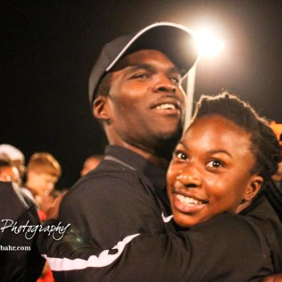 A cheerleader hugs Larned Indian Head Coach A B Stokes following the game. The Larned Indians defeated the Smoky Valley Vikings by a score of 28 to 14 at Earl Roberts Stadium in Larned, Kansas on September 8, 2017. (Photo: Joey Bahr, www.joeybahr.com)