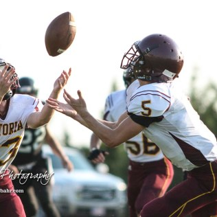 Victoria Knights #5 Collin Kisner and #33 Tyler Knoles both reach out for a ball that popped out of the hands of a Central Plains Oiler player in the second quarter. The Victoria Knights defeated the Central Plains Oilers by a score of 34 to 8 at Central Plains High School in Claflin, Kansas on September 2, 2017. (Photo: Joey Bahr, www.joeybahr.com)