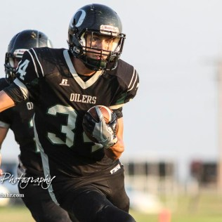 Central Plains Oiler #34 Alex Barton rushes with the ball in the third quarter. The Victoria Knights defeated the Central Plains Oilers by a score of 34 to 8 at Central Plains High School in Claflin, Kansas on September 2, 2017. (Photo: Joey Bahr, www.joeybahr.com)