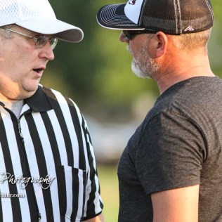 Head Referee Brad Taylor and Victoria Knight Head Coach Doug Oberle hold a discussion between the their and fourth quarters. The Victoria Knights defeated the Central Plains Oilers by a score of 34 to 8 at Central Plains High School in Claflin, Kansas on September 2, 2017. (Photo: Joey Bahr, www.joeybahr.com)