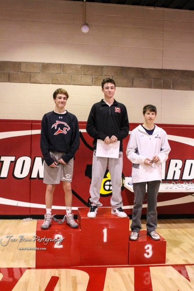 The 120 pound weight class finishers: First Place Jakob Snellings of Marysville, Second Place Carsyn Schooler of Great Bend, Third Place Braiden Lynn of Cimarron. The 2017 Cardinal Corner Classic Wrestling Tournament was held at Hoisington Activity Center in Hoisington, Kansas on December 15, 2017. (Photo: Joey Bahr, www.joeybahr.com)