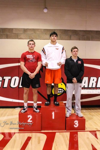 The 182 pound weight class finishers: First Place Chance Rodriguez of Holcomb, Second Place Wyatt Pedigo of Hoisington, Third Place Garron Champoux of Marysville. The 2017 Cardinal Corner Classic Wrestling Tournament was held at Hoisington Activity Center in Hoisington, Kansas on December 15, 2017. (Photo: Joey Bahr, www.joeybahr.com)