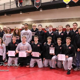 The Marysville team gathers to show off the team trophy and the brackets of their weight class winners after the tournament. The 2017 Cardinal Corner Classic Wrestling Tournament was held at Hoisington Activity Center in Hoisington, Kansas on December 15, 2017. (Photo: Joey Bahr, www.joeybahr.com)