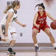 Hoisington Lady Cardinal #22 Iris Suarez tries to dribble away from the defense of Central Plains Lady Oiler #2 Rachel Lamatsch. The Central Plains Lady Oilers defeated Hoisington Lady Cardinals by a score of 88 to 23 in a basketball game held at Central Plains High School in Claflin, Kansas on December 1, 2017. (Photo: Joey Bahr, www.joeybahr.com)
