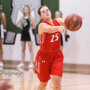 Hoisington Lady Cardinal #25 Maleigha Schmidt passes the ball to a teammate. The Central Plains Lady Oilers defeated Hoisington Lady Cardinals by a score of 88 to 23 in a basketball game held at Central Plains High School in Claflin, Kansas on December 1, 2017. (Photo: Joey Bahr, www.joeybahr.com)