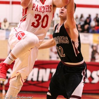 Great Bend Panther #30 Blake Penka goes for a layup as Buhler Crusader #12 Taiden Hawkinson defends. The Buhler Crusaders defeated the Great Bend Panthers by a score of 44 to 36 the Great Bend High School Field House in Great Bend, Kansas on January 12, 2018. (Photo: Joey Bahr, www.joeybahr.com)