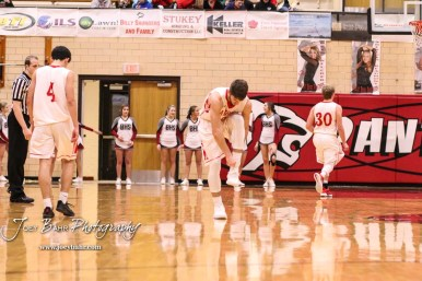 Great Bend Panther #5 Brock Blessing puts his shoes back on after loosing it. The Buhler Crusaders defeated the Great Bend Panthers by a score of 44 to 36 the Great Bend High School Field House in Great Bend, Kansas on January 12, 2018. (Photo: Joey Bahr, www.joeybahr.com)