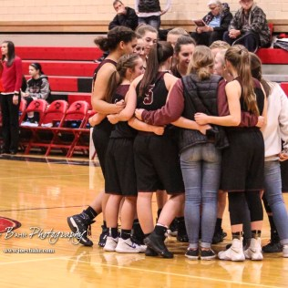 The Buhler Lady Crusaders huddle up prior to the game tipping off. The Great Bend Lady Panthers defeated the Buhler Lady Crusaders by a score of 52 to 38 the Great Bend High School Field House in Great Bend, Kansas on January 12, 2018. (Photo: Joey Bahr, www.joeybahr.com)