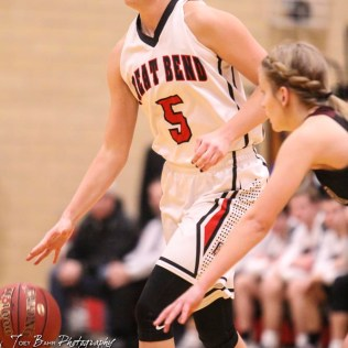 Great Bend Lady Panther #5 Camryn Dunekack dribbles around a Buhler Lady Crusader defender. The Great Bend Lady Panthers defeated the Buhler Lady Crusaders by a score of 52 to 38 the Great Bend High School Field House in Great Bend, Kansas on January 12, 2018. (Photo: Joey Bahr, www.joeybahr.com)