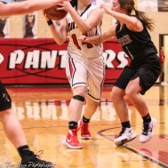 Great Bend Lady Panther #14 Kaylee Unruh looks to past the ball as Buhler Lady Crusader #11 Blythe Adkins defends. The Great Bend Lady Panthers defeated the Buhler Lady Crusaders by a score of 52 to 38 the Great Bend High School Field House in Great Bend, Kansas on January 12, 2018. (Photo: Joey Bahr, www.joeybahr.com)