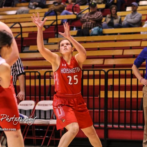 Hoisington Lady Cardinal #25 Maleigha Schmidt reaches up for an inbound pass. The Hoisington Lady Cardinals defeated the Ellinwood Lady Eagles by a score of 46 to 19 in the Consolation Semi-Final of the 2018 Hoisington Winter Jam at the Hoisington Activity Center in Hoisington, Kansas on January 18, 2018. (Photo: Joey Bahr, www.joeybahr.com)