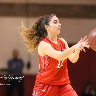 Hoisington Lady Cardinal #22 Iris Suarez passes the ball to a teammate. The Hoisington Lady Cardinals defeated the Ellinwood Lady Eagles by a score of 46 to 19 in the Consolation Semi-Final of the 2018 Hoisington Winter Jam at the Hoisington Activity Center in Hoisington, Kansas on January 18, 2018. (Photo: Joey Bahr, www.joeybahr.com)