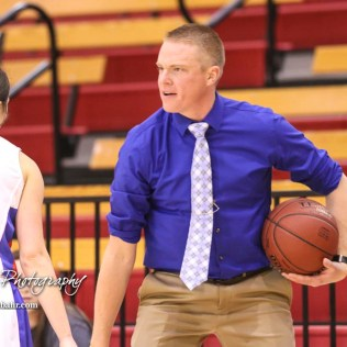 Ellinwood Lady Eagle Head Coach Andrew Cherry congratulates #22 Kennedy Harrington on a good defensive play. The Hoisington Lady Cardinals defeated the Ellinwood Lady Eagles by a score of 46 to 19 in the Consolation Semi-Final of the 2018 Hoisington Winter Jam at the Hoisington Activity Center in Hoisington, Kansas on January 18, 2018. (Photo: Joey Bahr, www.joeybahr.com)