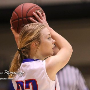 Ellinwood Lady Eagle #22 Kennedy Harrington looks for a teammate to pass the ball to. The Hoisington Lady Cardinals defeated the Ellinwood Lady Eagles by a score of 46 to 19 in the Consolation Semi-Final of the 2018 Hoisington Winter Jam at the Hoisington Activity Center in Hoisington, Kansas on January 18, 2018. (Photo: Joey Bahr, www.joeybahr.com)