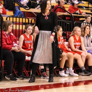 Hoisington Lady Cardinal Head Coach Mandy Mason follows a play down the court. The LaCrosse Lady Leopards defeated the Hoisington Lady Cardinals by a score of 32 to 27 in the First Round of the 2018 Hoisington Winter Jam at the Hoisington Activity Center in Hoisington, Kansas on January 16, 2018. (Photo: Joey Bahr, www.joeybahr.com)