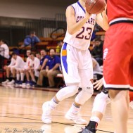 Otis-Bison Cougar #23 Maitland Wiltse shoots from the free throw line. The Ellsworth Bearcats defeated the Otis-Bison Cougars by a score of 58 to 37 in the Third Place game of the 2018 Hoisington Winter Jam at the Hoisington Activity Center in Hoisington, Kansas on January 20, 2018. (Photo: Joey Bahr, www.joeybahr.com)