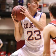 Otis-Bison Cougar #23 Maitland Wiltse looks for a teammate to pass the ball to. The Ellsworth Bearcats defeated the Otis-Bison Cougars by a score of 58 to 37 in the Third Place game of the 2018 Hoisington Winter Jam at the Hoisington Activity Center in Hoisington, Kansas on January 20, 2018. (Photo: Joey Bahr, www.joeybahr.com)