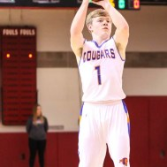 Otis-Bison Cougar #1 Blake Bahr shoots a three point shot. The Ellsworth Bearcats defeated the Otis-Bison Cougars by a score of 58 to 37 in the Third Place game of the 2018 Hoisington Winter Jam at the Hoisington Activity Center in Hoisington, Kansas on January 20, 2018. (Photo: Joey Bahr, www.joeybahr.com)