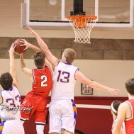 Otis-Bison Cougar #13 Clade Anderson tries to block a shot by Ellsworth Bearcat #2 Remington Cravens as contact is made. The Ellsworth Bearcats defeated the Otis-Bison Cougars by a score of 58 to 37 in the Third Place game of the 2018 Hoisington Winter Jam at the Hoisington Activity Center in Hoisington, Kansas on January 20, 2018. (Photo: Joey Bahr, www.joeybahr.com)