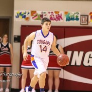 Otis-Bison Cougar #14 Seth Hoopingarner brings the ball down the court. The Ellsworth Bearcats defeated the Otis-Bison Cougars by a score of 58 to 37 in the Third Place game of the 2018 Hoisington Winter Jam at the Hoisington Activity Center in Hoisington, Kansas on January 20, 2018. (Photo: Joey Bahr, www.joeybahr.com)