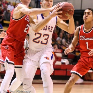 Ellsworth Bearcat #2 Remington Cravens tries to knock the ball away from Otis-Bison Cougar #23 Maitland Wiltse. The Ellsworth Bearcats defeated the Otis-Bison Cougars by a score of 58 to 37 in the Third Place game of the 2018 Hoisington Winter Jam at the Hoisington Activity Center in Hoisington, Kansas on January 20, 2018. (Photo: Joey Bahr, www.joeybahr.com)