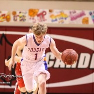 Otis-Bison Cougar #1 Blake Bahr brings the ball down the court. The Hoisington Cardinals defeated the Otis-Bison Cougars by a score of 58 to 46 in the Semi-Final of the 2018 Hoisington Winter Jam at the Hoisington Activity Center in Hoisington, Kansas on January 19, 2018. (Photo: Joey Bahr, www.joeybahr.com)