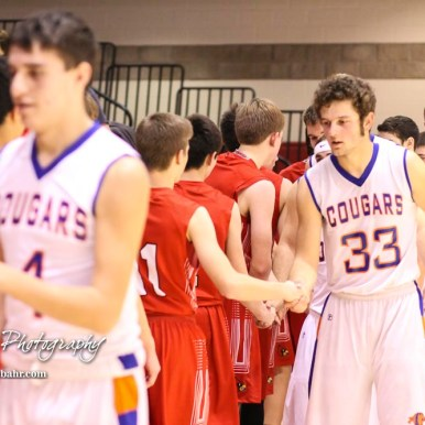 Members of the Hoisington Cardinals and Otis-Bison Cougars shake hands following the game. The Hoisington Cardinals defeated the Otis-Bison Cougars by a score of 58 to 46 in the Semi-Final of the 2018 Hoisington Winter Jam at the Hoisington Activity Center in Hoisington, Kansas on January 19, 2018. (Photo: Joey Bahr, www.joeybahr.com)