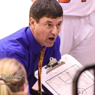 Otis-Bison Lady Cougar Head Coach Robert Trapp draws up a play for his players during a timeout. The Otis-Bison Lady Cougars defeated the LaCrosse Lady Leopards by a score of 29 to 23 in the Semi-Final of the 2018 Hoisington Winter Jam at the Hoisington Activity Center in Hoisington, Kansas on January 19, 2018. (Photo: Joey Bahr, www.joeybahr.com)