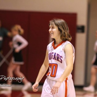 Otis-Bison Lady Cougar #20 Sheridan Ewy smiles in celebration after the final buzzer as her side won the game. The Otis-Bison Lady Cougars defeated the LaCrosse Lady Leopards by a score of 29 to 23 in the Semi-Final of the 2018 Hoisington Winter Jam at the Hoisington Activity Center in Hoisington, Kansas on January 19, 2018. (Photo: Joey Bahr, www.joeybahr.com)